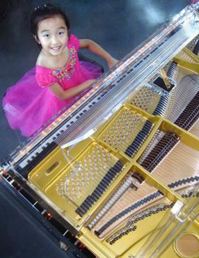 Virtuosic Phoenia Gao approached her eighth birthday by playing Theodore Oesten's Doll's Dream on a $200,000 Schimmel K213 Glass grand piano.